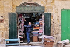 M. Mallia (Douguerreotype) Tags: candid city people shop street urban malta architecture valletta sign door store