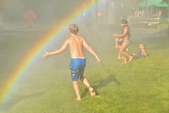 Catching a rainbow (radargeek) Tags: internationalmudday okc oklahomacity myriadgardens downtown kid kids child children rainbow spray shower june 2018