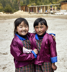 Bhutan: School Children of Haa Valley III. (icarium.imagery) Tags: bhutan drukyul himalayas buddhist captureone child expression girls haa haavalley localpeople mahayanabuddhism naturallight portrait rural schoolchildren smiling sonydscrx1rm2 street streetportrait traditionalclothing traditional traditionaldress travel two vibrant
