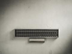 Lights Out - Genova, Italy (Sebastian Bayer) Tags: lampe leuchtstoffröhre monochrom formen zerfall linien schmutz risse schatten minimalistisch elektrik technik bahnhof italien schwarzweis licht genua wand