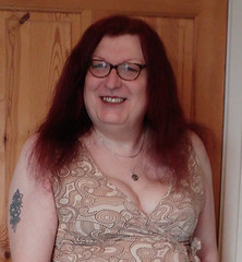 Multi patterned dress semi close up (dianne66uk) Tags: transwoman heels hosiery redhair glasses