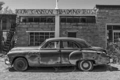 Cow Canyon Trading Post. (Element1983) Tags: tradingpost post cowcanyon cowcanyontradingpost monumentvalley roadtrip old buick bw contrast highnoon sony sony50mm 50mm