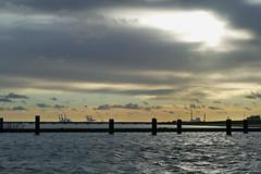 Jade unter dunklen Wolken (antje whv) Tags: jade hooksiel wilhelmshaven containerhafen jadeweserport wolken clouds gegenlicht contrejourshots