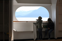 Enjoying the View (Anthony Mark Images) Tags: mountains shipsbow people portrait photographer jeans runningshoes enjoyingtheview ship cruiseship hollandamericalines mseurodam opening water ocean