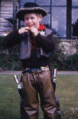 Low cost play (theirhistory) Tags: boy children kid cowboy holster gun pistol badge jacket hat