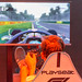 Visitor sitting in a Playseat gaming seat and playing F1 2018