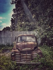 back against the wall...(HTT) (BillsExplorations) Tags: truck chevytruck chevrolet gm rust old vintage truckthursday fulton illinois graveyard scrapyard forgotten abandonedtruck abandonedillinois decay flair sun wall backagainstthewall