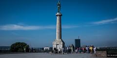 2018 - Serbia - Belgrade Fortress - Victory of Liberty (Ted's photos - For Me & You) Tags: 2018 belgrade cropped nikon nikond750 nikonfx serbia tedmcgrath tedsphotos vignetting victorofkalemegdan belgradeserbia monument statue people