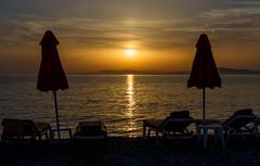 Sun bathing (pbr53) Tags: rodos decentralizedadministrationof greece decentralizedadministrationoftheaegean gr sunset reflections aegeansea beach
