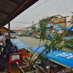 Heavy rain shower at Amphawa floating market in Samut Songkhram province near Bangkok, Thailand thumbnail
