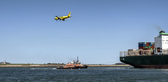 Departure--Arrival (PAJ880) Tags: plane landing boston ma harbor airport tugs ha reinauer freedom container ship ever leading departure arrival