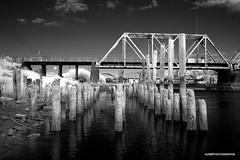 Train bridge - infrared (JSB PHOTOGRAPHS) Tags: dsc604100001 infraredconvertedcamera infrared blackandwhite reedsport oregoncoast oregon trainbridge nikon d70 18300mm capturenxd