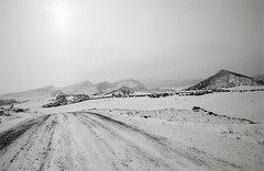 wyoming winter, part three (manyfires) Tags: wyoming rural farm ranch roadtrip winter snow cold nikonf100 35mm analog film road drive driving mountains landscape bw blackandwhite