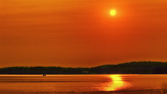 A 'Smokin' Sunset (Bob's Digital Eye) Tags: aug2018 boat bobsdigitaleye canon flicker flickr laquintaessenza lake lakesunset reflection silhouette smokepollution sun sunset sunsetsoverwater t3i water canonefs55250mmf456isstm sky serene