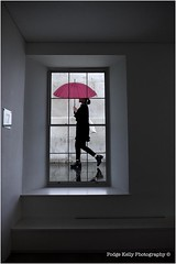 02 PodgeKellyPhotography© (Podge Kelly) Tags: second umbrella window windowlight walking rain double exposure red woman watching gallerywindow london