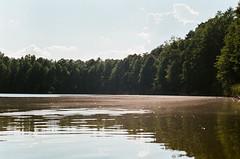 Anxiety (Tamar Burduli) Tags: analog film color 35mm lake sky clouds forest trees treeporn water waterscape nature landscape tamarburduli travel poland summer trip zenit kodak
