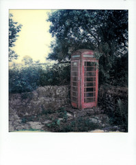The Lost Phone Box (gooey_lewy) Tags: polaroid scan sx70 land camera instant film photography lost phone box rural wales take over garden corner red