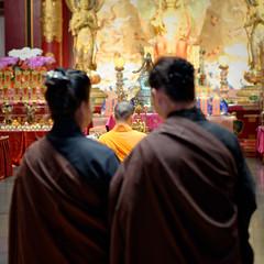 Facing the Buddha (claustral) Tags: monk buddhism ceremony religion interior singapore 2018 buddhatoothrelictemple monks maitreya ritual