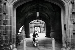 R1-016-6A (David Swift Photography) Tags: davidswiftphotography newjersey princetonnj princetonuniversity architecturaldetail archways architecture historicbuildings collegecampus bikes candidportrait streetphotography 35mm ilfordxp2 olympusstylusepic portals