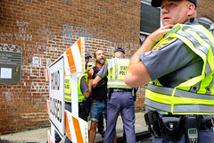 Minor altercation (nataliekrovetz) Tags: aug11 a12 xt2 police arrest charlottesville sign people streetphotography fujifilmxt2 journalism cops tension cville