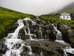 Waterfall (Feldore) Tags: faroeislands bøur waterfall faroe islands feldore mchugh em1 olympus 1240mm water village green grass landscape