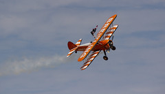 The Flying Circus Wingwalking Team, Shuttleworth Collection Family Air Show, Bedfordshire (IFM Photographic) Tags: img4014a breitlingstearman breitling stearman theflyingcircuswingwalker wingwalker wingwalking nikita aerosuperbatics canon 600d sigma70200mmf28exdgoshsm sigma70200mm sigma 70200mm f28 ex dg os hsm apo tele converter 2x af teleconverter oldwarden bedfordshire beds shuttleworthcollection shuttleworthhouse familyairshow airshow aircraft aeroplane plane airplane boeing