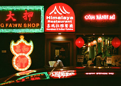 """""""cơm bánh ... himalaya ... pawn"""" (hugo poon - one day in my life) Tags: rollei35 film hongkong wanchai taiwongstreeteast wocheongpawnshop restaurant eating citynight dark colours lights sign dinner reminiscing reflections red shop fujifilmsuperiaxtra400"""
