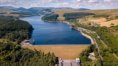 Aerial drone view of low water levels in Pontsticill Reservoir, Brecon Beacons during a summer heatwave (WhitcombeRD) Tags: change dry bridge brecon nature water land tourist lake globalwarming hot above drone uk scenic wave sky climatechange global welsh earth drought beautiful climate pontsticill warming river ecology rain aerial arid landscape summer heat wales shortage breconbeacons scenery britain travel empty aerialview level heatwave plant low tourism beacons reservoir
