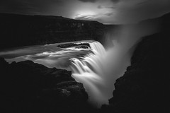 Gullfoss Waterfall, Iceland (S.A.W. Pixels) Tags: artistic amazing arts black white canon art iceland atlantic dramatic dark darkclouds drama excellent exposure exciting explore explored exposed flickr greatphotographers interesting impressive landscape landscapes outdoor observing outside overcast picture panaromic photo syedaliwarda sea sky mountain ocean water waterfalls rock waterfall grass gullfoss gullfosswaterfall blackandwhite monochrome