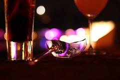 Shattered Glass (Nathalie_Désirée) Tags: shatteredglass bokeh minimalistic art artistic heel highheel broken shattered wreck lost color colors glass wine ramazzotti liquid drink barware evening darkness canoneos600d canon35mm