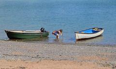 Getting The Shot. (curly42) Tags: devon dawlish seaside beach boats water girl photographer