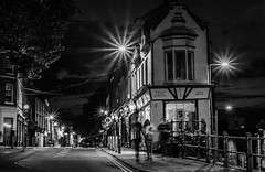 Evening's end  (3 of   3)  (Explore #13) (+Pattycake+) Tags: goinghome street people norwich architecture buildings evening city walking road monochrome bw blackandwhite night starbursts f11 paving uk