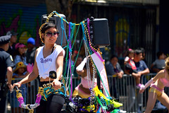 Carnaval Parade SF 193 (TheseusPhoto) Tags: colors colorsoftheworld people candid streetphotography street city citylife carnaval carnaval2018 carnavalsf sanfrancisco sanfran california parade costume girl woman smile happy sunglasses