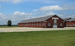 Pickwick Farms Barn — Holmes Township, Crawford County, Ohio (Pythaglio) Tags: crawfordcounty ohio historic onestory brick classicalrevival massive long elongated barn pickwickfarms holmestownship bucyrus tripartite windows entablature capitals piers pilasters doorway doors parkinglot tree field farmland rural agriculture building structure chuckwalt ca1921