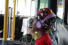 Tuned out (LolaKatt) Tags: bus publictransportation color photography colorphotography people peoplephotography canon canonphotography canonrebelt2i larisakarr daytime asheville nc northcarolina usa us unitedstates