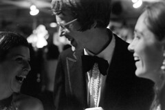 120270 24 (ndpa / s. lundeen, archivist) Tags: nick dewolf nickdewolf blackwhite photographbynickdewolf bw 1970 1970s 35mm film monochrome blackandwhite december boston massachusetts mass people unidentified party socialevent partyguest woman youngwoman partyguests women youngwomen mingling longhair man glasses eyeglasses tux tuxedo blackjacket blacktie tie bowtie laugh laughing laughter governmentcenter cityhall bostoncityhall youngman