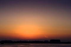 Popping up (Wouter de Bruijn) Tags: fujifilm xt2 fujinonxf56mmf12r sunrise dawn morning sun rising orange purple landscape nature water lake veersemeer veere walcheren zeeland nederland netherlands holland dutch outdoor