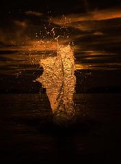 liquid gold (petrisalonen) Tags: sunset magma gold liquid water sun splash art fast orange yellow light pattern figure lake finland sky clouds sunlight