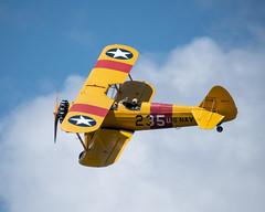 Stearman_117747 (gpferd) Tags: 2xteleconverter airplane boeingn2s clouds people stearman vehicle vintageairplane