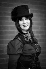 Portrait from the Whitby Steampunk Weekend IV - Days Like These (Gordon.A) Tags: yorkshire whitby steampunk whitbysteampunkweekend iv dayslikethese wsw july 2018 convivial creative costume hat culture lifestyle style fashion lady woman people street wall festival event eventphotography outdoor outdoors outside amateur streetphotography pose posed portrait streetportrait blackandwhite bnw bw mono monochrome monochromatic naturallight naturallightportrait digital canon eos 750d sigma sigma50100mmf18dc