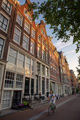Morning Ride in Amsterdam (Rob Shenk) Tags: europe europe2018 vacation dutch travel canals cityscapes water amsterdam cyclist bike bicycle riding dawn