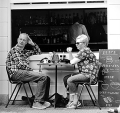 Relaxing in Amsterdam Cafe (Clare-White) Tags: amsterdam cafe candid people sitting lady eating bw light table outside 7dwf street tourists