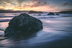 Moody Beach Scene (Manuela Durson) Tags: bandon oregon oregoncoast southernoregon ocean water pacificocean beach coast coastal coastline landscape nature sunset sunsetoverwater sunsetoverocean sea seascape seastacks seastack cliffs moody mood evening