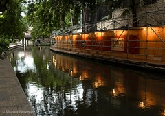 From one end of the river... (photo.po) Tags: construction scaffolding canonef24mmf28stm water river riverwalk canont6 canonphotography canon tranquil colors oasis urban reflection lights availablelight sanantonioriverwalk sanantonio texas