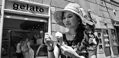 Gelato. (Baz 120) Tags: candid candidstreet candidportrait city candidface candidphotography contrast street streetphoto streetphotography streetcandid streetportrait strangers sony a7 rome roma europe women monochrome monotone mono noiretblanc bw blackandwhite urban life primelens portrait people italy italia girl grittystreetphotography faces decisivemoment
