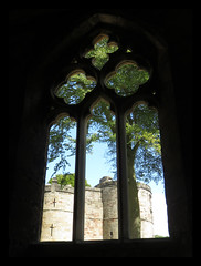 Skipton Castle. Through The Chapel Window (M E For Bees (Was Margaret Edge The Bee Girl)) Tags: window skipton castle light arch ancient old indoors outdoors sun summer shade canon chapel northyorkshire stone architecture medievil