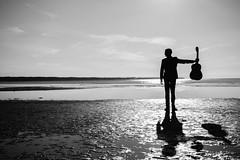 Vahur Kubja, a classical guitarist (Rait_Tuulas) Tags: portrait musician guitarist bw monochrome beach silhouette estonia eesti tallinn
