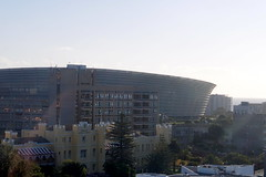 Somerset Hospital and Stadium, Cape Town, South Africa (mattk1979) Tags: southafrica capetown sun outdoors sky clouds city mountains ocean tablebay water victoriabasin vawaterfront jetty fishing boats ferris wheel above aerial