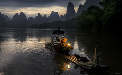 Cormorant fisherman with lamp (Dan_Fr) Tags: guilin guangxi xingping li river yangshuo cormorant fisherman birds tradition custom dawn sunrise travel landscape mountain hill karst scenery china water reflection sky beautiful amazing sony a7r raft boat bamboo