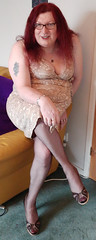 Multi patterned dress sitting (dianne66uk) Tags: transwoman heels hosiery redhair glasses